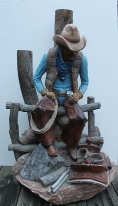 APSIT BROTHERS SCULPTURAL LAMP. COWBOY SEATED ON FENCE RAIL.