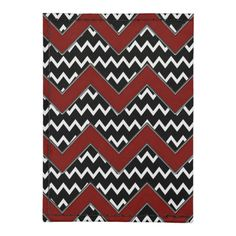 Black and white chevron pattern with large red chevron overlay.