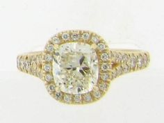 One of our Favorites!  A yellow gold pave split shank ring with cushion center and halo