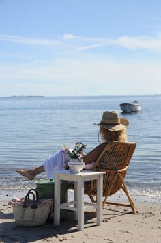 relaxing, this is what I do when I go beaching, at 62 I like to sit and read