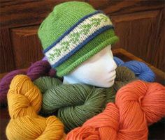 """Amber by Susan Lawrence:   """"This unisex hat is knit entirely on circular needles, making it the perfect project for the adventurous beginner or anyone intimidated by double-pointed needles. If the two-color stranded pattern doesn't appeal to you, replace it with a simple stripe or carry a strand of thin mohair yarn together with the wool when you work the rounds between the two raised ridges.  Be creative with your color choices."""""""