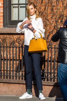 Karlie Kloss wearing Adidas Originals Stan Smith Sneakers, Louis Vuitton Capucines MM Tote and Victoria Beckham Ribbed Stretch Wool-Blend Turtleneck Sweater
