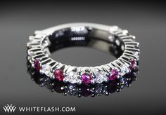Diamonds for an Eternity 3/4 Diamond Wedding Ring has been customized to feature alternating rubies and diamonds.