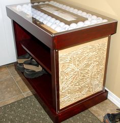 This bench top is filled with golfballs and a small sand trap and then covered it with plexiglass. The side is also filled with golf T's and held into place with plexiglass.