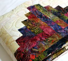 Log Cabin Quilt in Prairie Jewels Batiks 56 x 76 by QuiltLover  Like the colors
