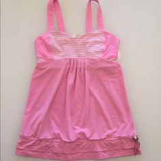 Lululemon Back On Track Tank Lululemon Back On Track Tank. Size 8. GUC. Built in sports bra and cinch cord at the bottom. Adorable bright bubble gum pink, white and grey colors. No trades! Bundle to save! Thanks! lululemon athletica Tops Tank Tops