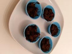 Chocolate Cups - dark non-dairy chocolate with raisins, flax seed, flaked almonds and dates.