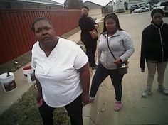 Bodycam video from a white Fort Worth police officer who was suspended for wrestling a black woman and her daughter to the ground appears to show the officer using his foot to push the 15-year-old girl into a police car.