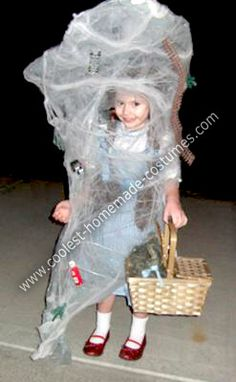 Homemade Dorothy in a Tornado from Wizard of Oz Costume: In honor of the 70th Anniversary of the Wizard of Oz, my little girl wanted to be Dorothy. We wanted to add a twist to just making a standard Dorothy costume,