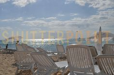 The white sand beaches and empty chairs are waiting - Stock Photo
