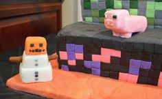 """Minecraft pig and snowman made with rice krispy, covered with MMF fondant.   Lava is MMF fondant marbled with five shades of orange and a dark red.   (Please excuse the powder sugar dust.  Can easily """"cleaned up"""" with a handheld steamer)"""