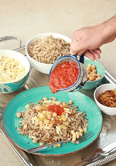 Koshari | Kushari - Egyptian Street Food - African, Egypt, Entree, Middle Eastern, Rice Recipes, Rice Recipes, Street Food Koshari or Kushari is a very popular Egyptian Street Food that is made with Rice, lentils and Pasta which is then topped with a spicy tomato sauce and cara Koshari