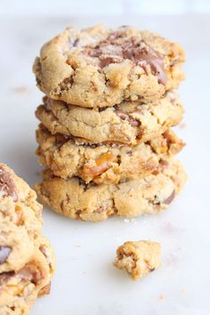 Thick, chewy, peanut butter chunker cookies are stuffed with peanut butter, chocolate, pretzels, peanuts, toffee, oatmeal and hints of cinnamon spice.