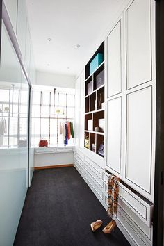 The walk-in wardrobe is a mix of what both the husband and wife wanted. On the left, the husband's wardrobe is hidden behind sleek, embellishment free glass while on the right, the wife's wardrobe showcases classic doors with moulding details.