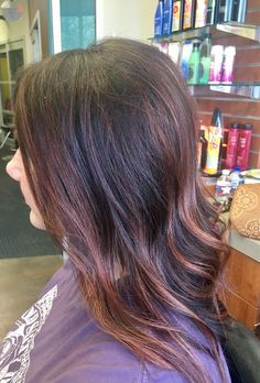 Brunette hair with burgundy balayage with cherry and rose gold pieces too! I love my hair stylist! Thank you Kristin!