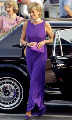 Princess Diana in Chicago wearing a purple Versace dress with a purple bag by Jimmy Choo.