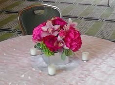 This is a cube vase floral arrangement that features hydrangea, peonies and cymbidium orchids in different shades of pink. See our entire selection at www.starflor.com.  To purchase any of our floral selections, as gifts or décor, please call us at 800.520.8999 or visit our e-commerce portal at www.Starbrightnyc.com. This composition of flowers is generally available for same day delivery in New York City (NYC). SQ270