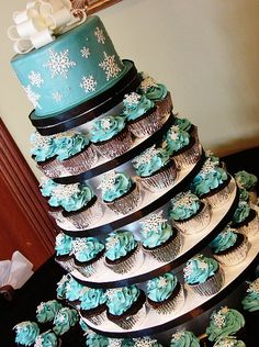 This is the idea that I want with one of the colors I want. Just no snow flakes. Probably a coral flower. I want the mini wedding cake with tiers of cupcakes!