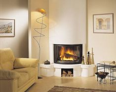 See more ideas about Tiled fireplace, Fireplace remodel and White fireplace surround. #fireplace #cornerfirplace #firplacetile