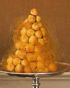 Croquembouche! This has to be one of the neatest and messiest looking deserts I have ever seen and makes a great centerpiece at the same time. I noticed that this takes a lot of TLC to make, but I'm sure it is worth it! Gotta try it out before making it for company!!
