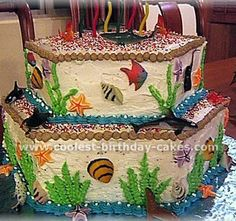 My son's 6th birthday party was held in the aquarium. So we thought it would be nice to have an under the ocean cake to go with the theme. I used 2 of Wilton's hexagon pans in different sizes, put the smaller cake on top of the bigger one. For decoration I used sea creatures made from sugar (available in most cake decorating stores) and also some plastic sea creatures.