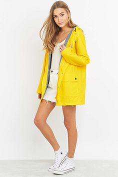 Petit Bateau Yellow Anorak -  Yellow raincoat with blue and white striped lining. I want this in my life!