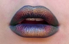 "Oil Slick Lips - ""So I started out with a dark green eyeliner and lined/coloured the lip and then used a variety of eyeshadows to blend and create the colours. I used the Stila duo eyeshadows because of their refined beautiful finish.. and just worked it."""