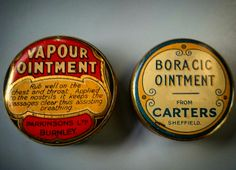 A pair of antique ointment tins with contents