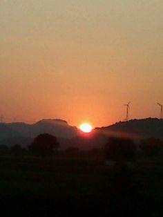 Windmills in the sunset, on the Bangalore-Mumbai road