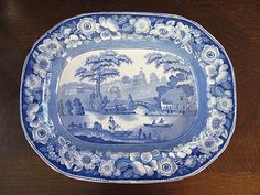 Beautiful English 1860 blue transfer ware platter!!! 15.5x12. Countryside scene with folks fishing. Beautiful roses around the perimeter of platter. Pattern is Wild Rose. marked on the bottom in same shade of blue. No damage, great condition.