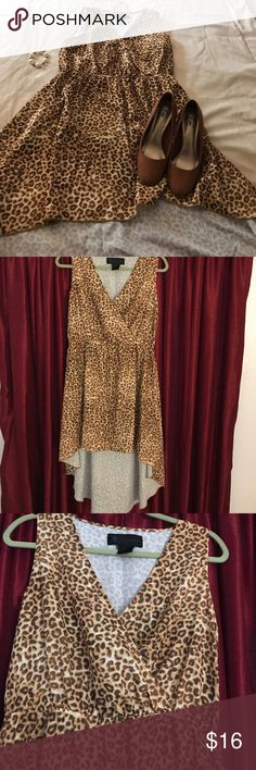 Kardashian Kollection high low dress size L 100 % polyester Kardashian Kollection high low cheetah design dress, size L. In great condition size L Kardashian Kollection Dresses High Low