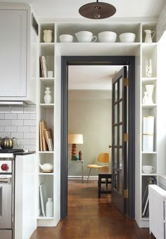 For things like jars or cups, you can create special storage compartments around the door frame.