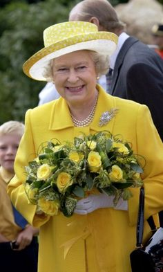 Queen Elizabeth held on to a bouquet of yellow roses, which matched her yellow attire, during her royal visit to the Channel Islands.
