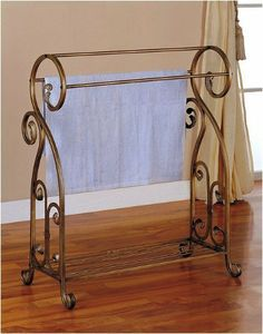 "Antique Gold Finish Metal Towel/ Quilt Rack by AtHomeMart. $60.50. Dimension: 14 3/4""L X 31""W X 36""H. Brand New in Original Box. Easy assembly required. Strong Construction. Perfect for space saver. Antique Gold Finish Metal Towel/ Quilt Rack. Towel rack in antique metal finish featuring scroll design, three towels storage and base shelf. Special designed and fine working describe this beautiful furniture."