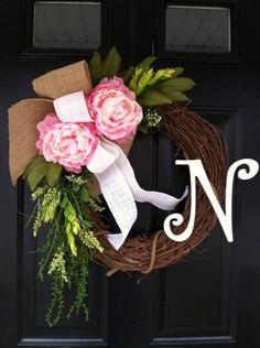 NEW design for spring and summer ! 2 perfect pink peonies blossoms with a mix of greens . a large burlap bow and a smaller white burlap bow add a