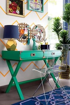 If you want a desk with a stylish design and an adventurous spirit, our Campaign Desk is the perfect candidate. Its two solid wood drawers provide plenty of storage and its brass colored drawer pulls and corner accents give it a refined touch. Plus, it's available in multiple bold colors that'll stand out in any room.