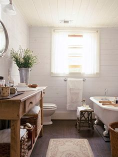 i love the vintage feel with the old school tub.  I especially love the stool idea for a decoration.  I also saw somewhere a painted chair that could be used in place of the stool.