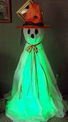 Halloween DIY~ One large tomato cage One large styrofoam ball One rope light - your choice of color. I used green for an eerie feel. One twin size flat white sheet. One spool of ribbon. One child size witch hat Halloween Prop, Halloween 2015, Outdoor Halloween, Halloween Ghosts, Diy Halloween Decorations, Holidays Halloween, Halloween Crafts, Holiday Crafts, Holiday Fun