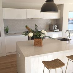 House by the water kitchen. Doesn't our kitchen look swish? I glammed the house up a bit with some greenery in honour of my Mum's visit and the return of The Three Little Pigs from holidays with g… Kitchen Splashback Tiles, Kitchen Flooring, Kitchen Cabinets, Kitchen Layout, New Kitchen, Stone Kitchen, Kitchen Interior, Kitchen Decor, Kitchen Ideas