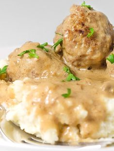 Beef and pork meatballs simmered in a creamy mushroom sauce and piled high on creamy mashed potatoes.
