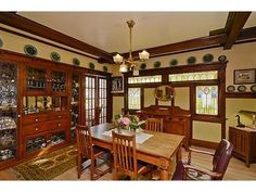 Flush With Quarter Sawn Oak Wainscoting, Beamed Ceilings, And A  Leaded Glass Breakfront, The Dining Room Invites Both Gracious Entertaining  And Quiet Family ...