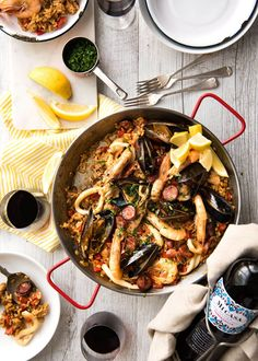 An authentic, EPIC Spanish Paella! Easy to make with step by step photos, load…