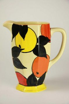 A Clarice Cliff Bizarre 'Athens' jug, circa 1930-36, the octagonal sided jug with flared foot and square angled handle displaying the 'Oranges and Lemons' pattern in yellow, orange and black. Stamped to base Newport pottery England. Height 16.5 cm