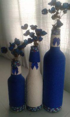 garrafas decoradas em barbantes ara enfeites de  sala
