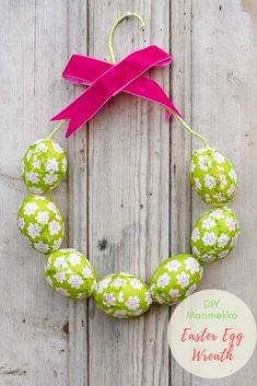 Bring some spring colour and cheer to your decor this spring with this very simple Marimekko Easter Egg wreath.  All you need are eggs and paper napkins. #easterwreath #marimekko #eggs