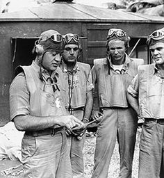 VMF-214. Greg (Pappy) Boyington briefs his Black Sheep pilots at an airfield in the New Hebrides.