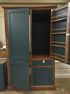 Kitchen Larder unit with integrated fridge freezer unit. Bespoke and made to order by Cobwebs Furniture Company.