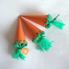 Make cute little carrot bags to fill with treats this Easter. You just need orange card and green wool.