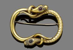 A serpent brooch, circa 1850. Modelled as two snakes, one head set with a cabochon ruby within an old brilliant-cut diamond surround with rose-cut diamond eyes, the other of textured finish and similar design set with a cabochon sapphire, each tail intertwined around the other's head to create a curved square outline, later pin fitting, length 6.5cm