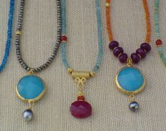 Very long multi-gem mala inspired necklace with turquoise, carnelian, and hessonite with gold plated tassel .